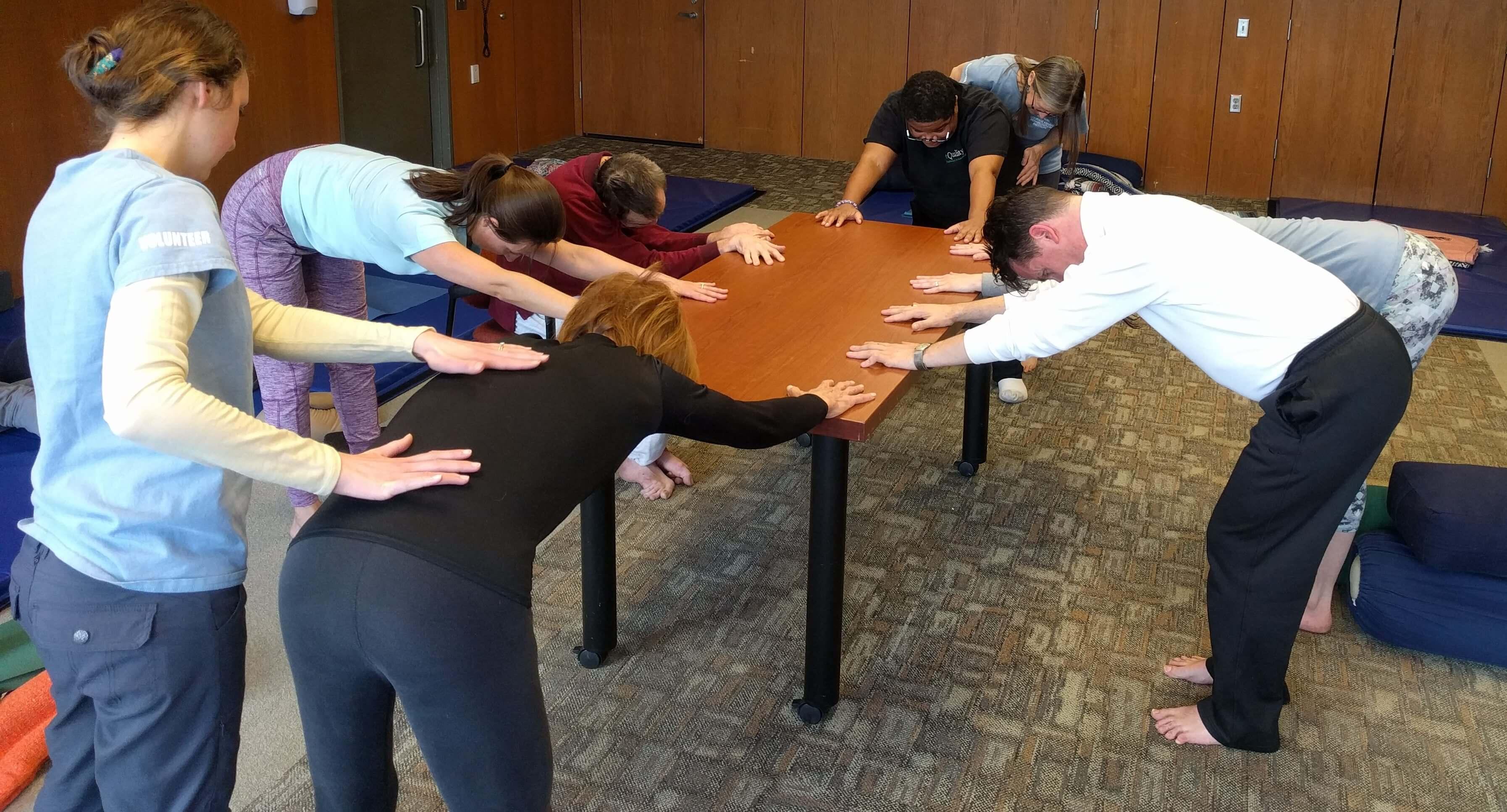 students practicing downward facing dog