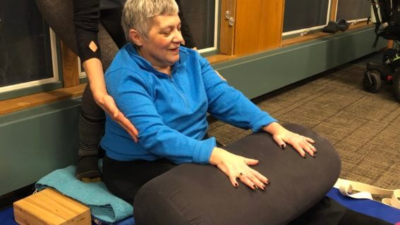 Adaptive yoga student and assistant