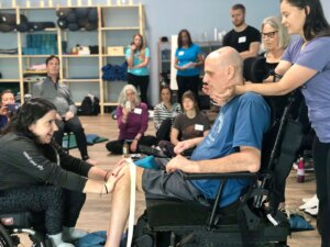 Laura Hallisey and Joe Dailey at yoga workshop